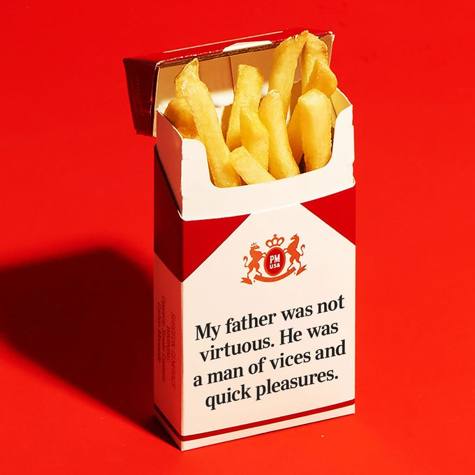 """cigarette package with french fries instead. box reads, """"My father was not virtuous. He was a man of vices and quick pleasures."""""""