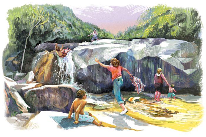 children play near a waterfall; mother runs towards her son as he falls