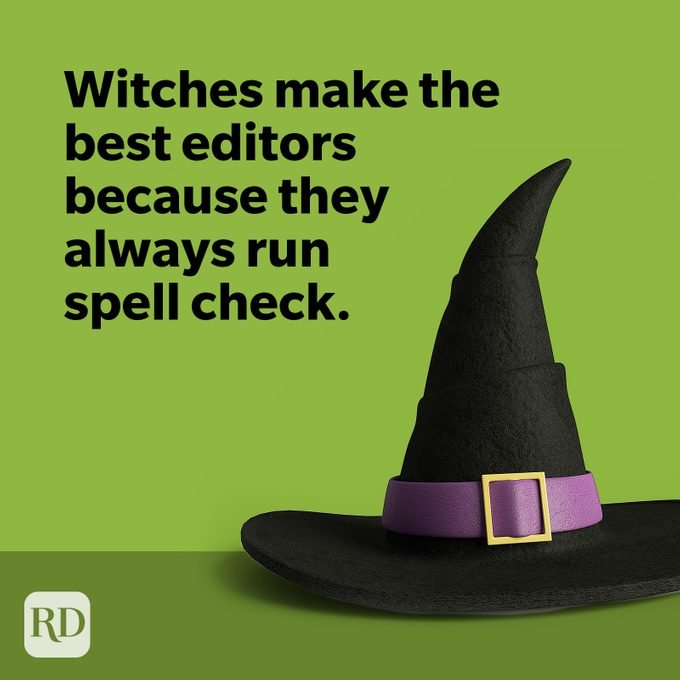 Black witch hat with purple buckle on green background