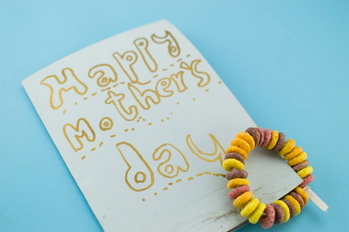 child gives mother's day a necklace and bracelet of cereals