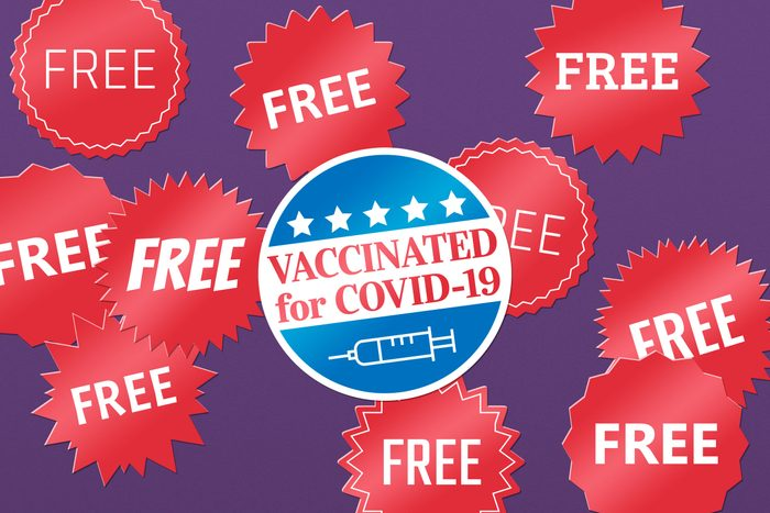 """""""free"""" stickers with a """"vaccinated for covid-19"""" sticker in the center"""