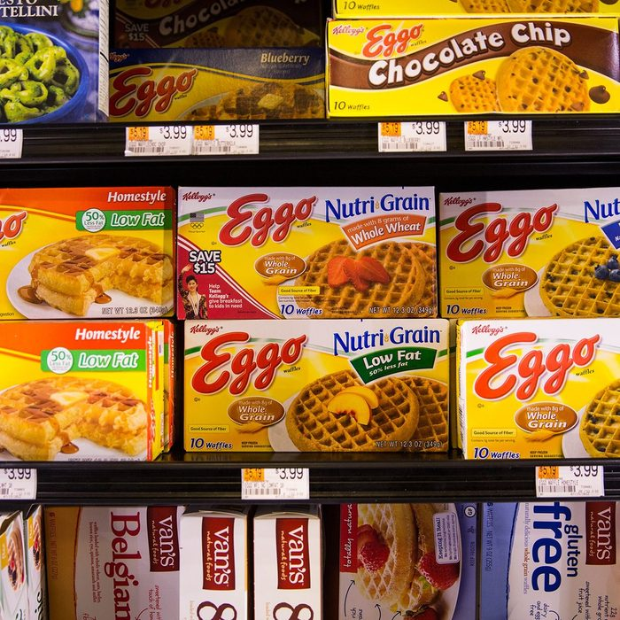boxes of eggo waffles in a grocery store freezer