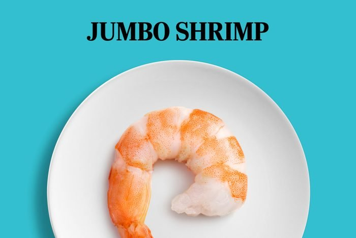 large shrimp that takes up most of the space on a white plate; text: Jumbo Shripm