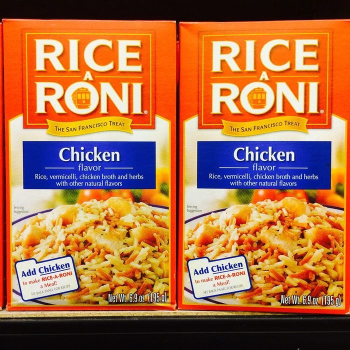 boxes of rice-a-roni on a shelf in the grocery store