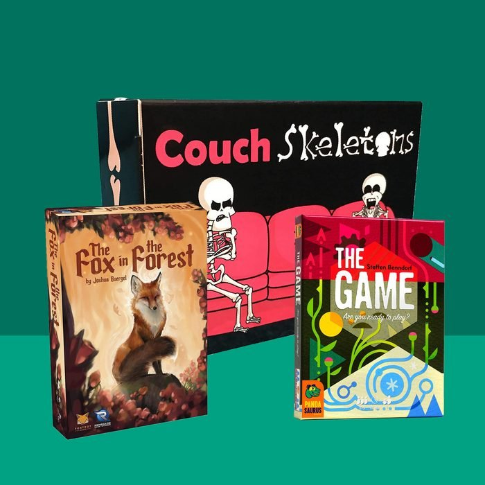 Three 2 player card game covers in front of green background