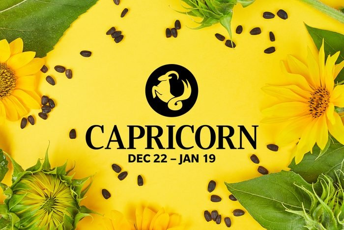 Capricorn symbol and dates over summery background