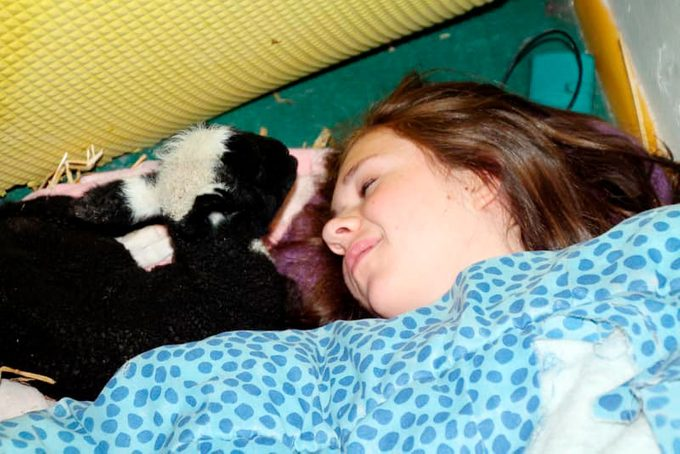 Grace sleeping with the baby goat