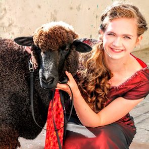 Grace, dressed for the homecoming dance, and Esther, the goat, dressed in a matching tie
