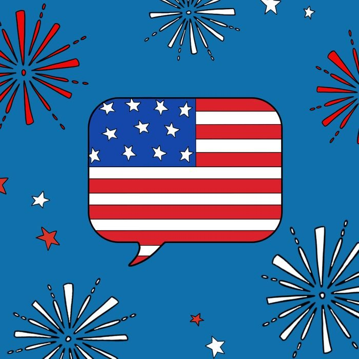 Speech bubble containing elements of the American flag, surrounded by firework doodles