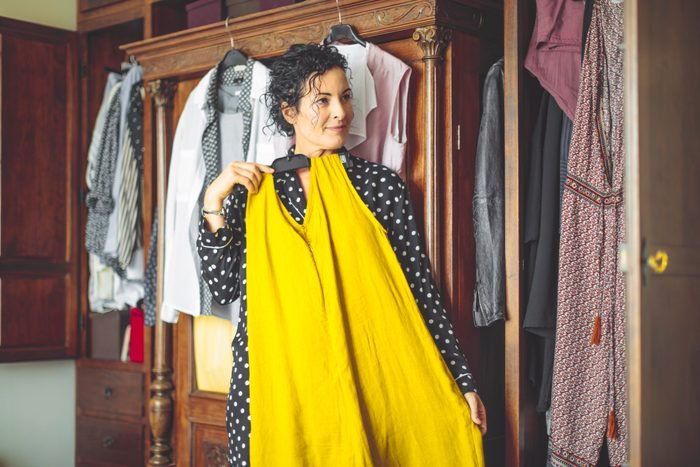 Woman is choosing the right dress to wear