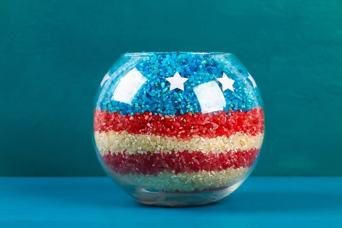 Diy 4th of July vase of glass jars and colored rice American flag, red, blue, white.
