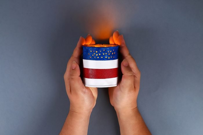 Diy 4th of July tin can candlestick, electric tape, paint color American flag, red, blue, white.