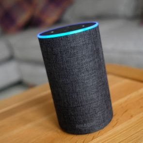 Amazon Echo device with Alexa on a coffee table in a living room