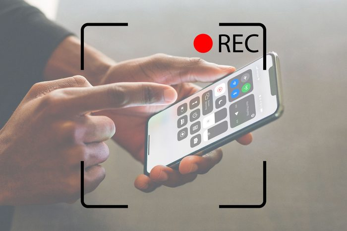 person using screen recording on an iphone with recording screen overlay