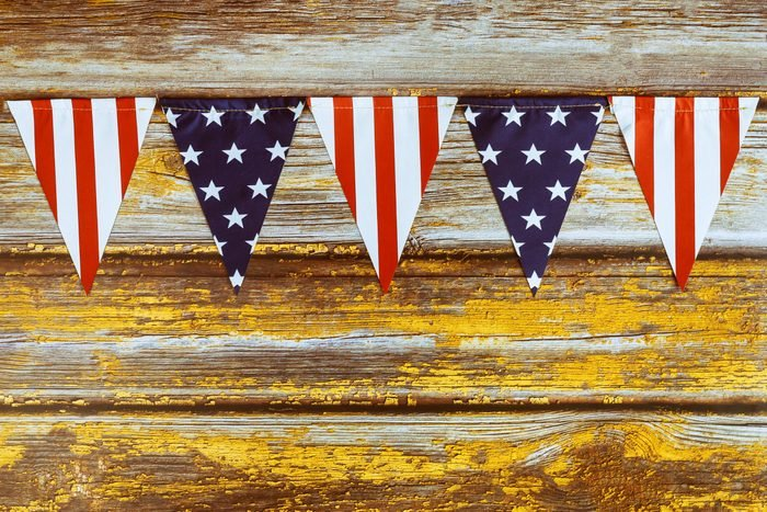 stars and stripes pennant banner on wood background