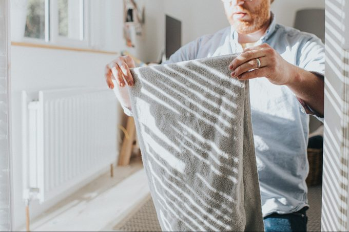 Folding a towel for the linen closet