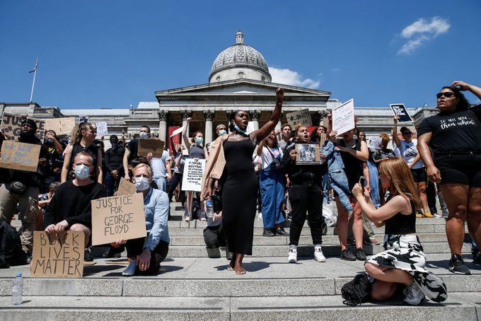 People with signs gather for a Black Lives Matter protest in London, England