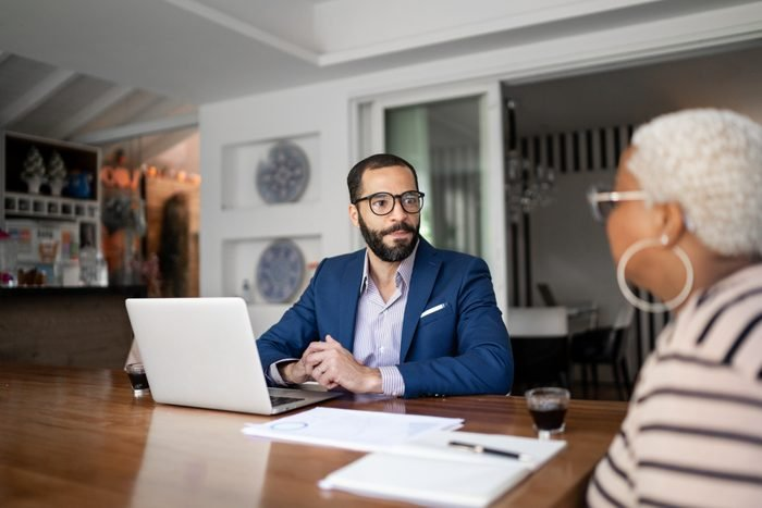 Woman talking to finance advisor at home