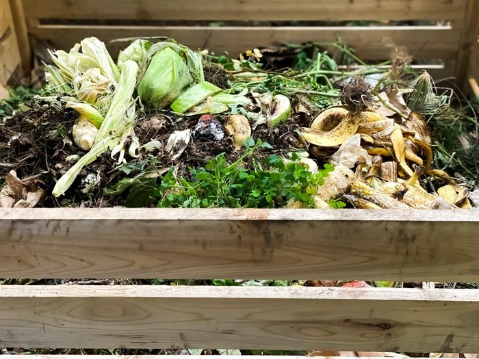 full wooden compost bin