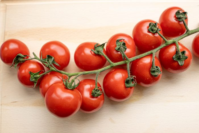 Cherry tomato on a cutting board