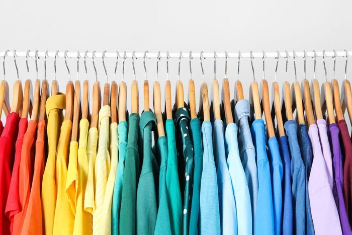 rack of clothes organized by color