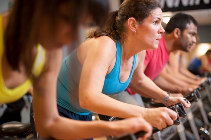 woman participating in full capacity spin class