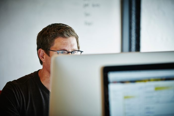 Businessman sitting at desk working on computer