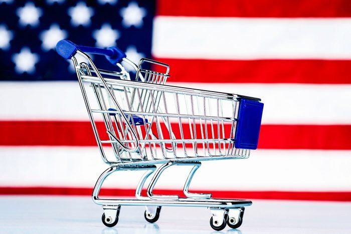 shopping cart with american flag background for memorial day sales concept