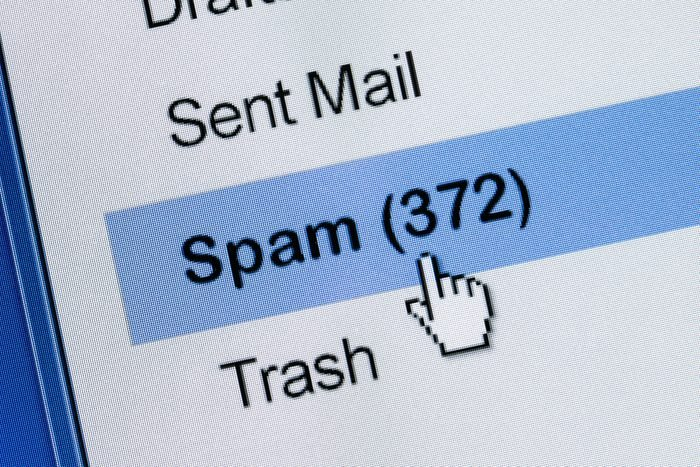computer cursor clicking on email spam folder with 372 items