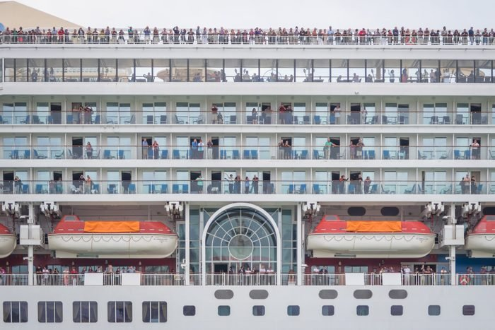 side segment of a cruise ship with passengers on all levels