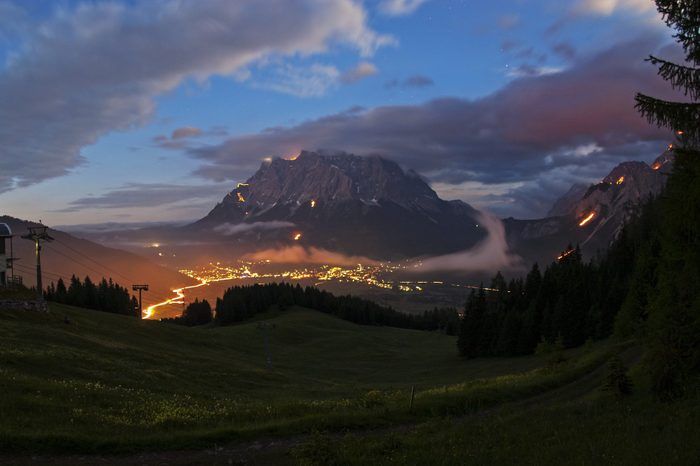 Mountain bonfires during solstice in Tyrol, Austri