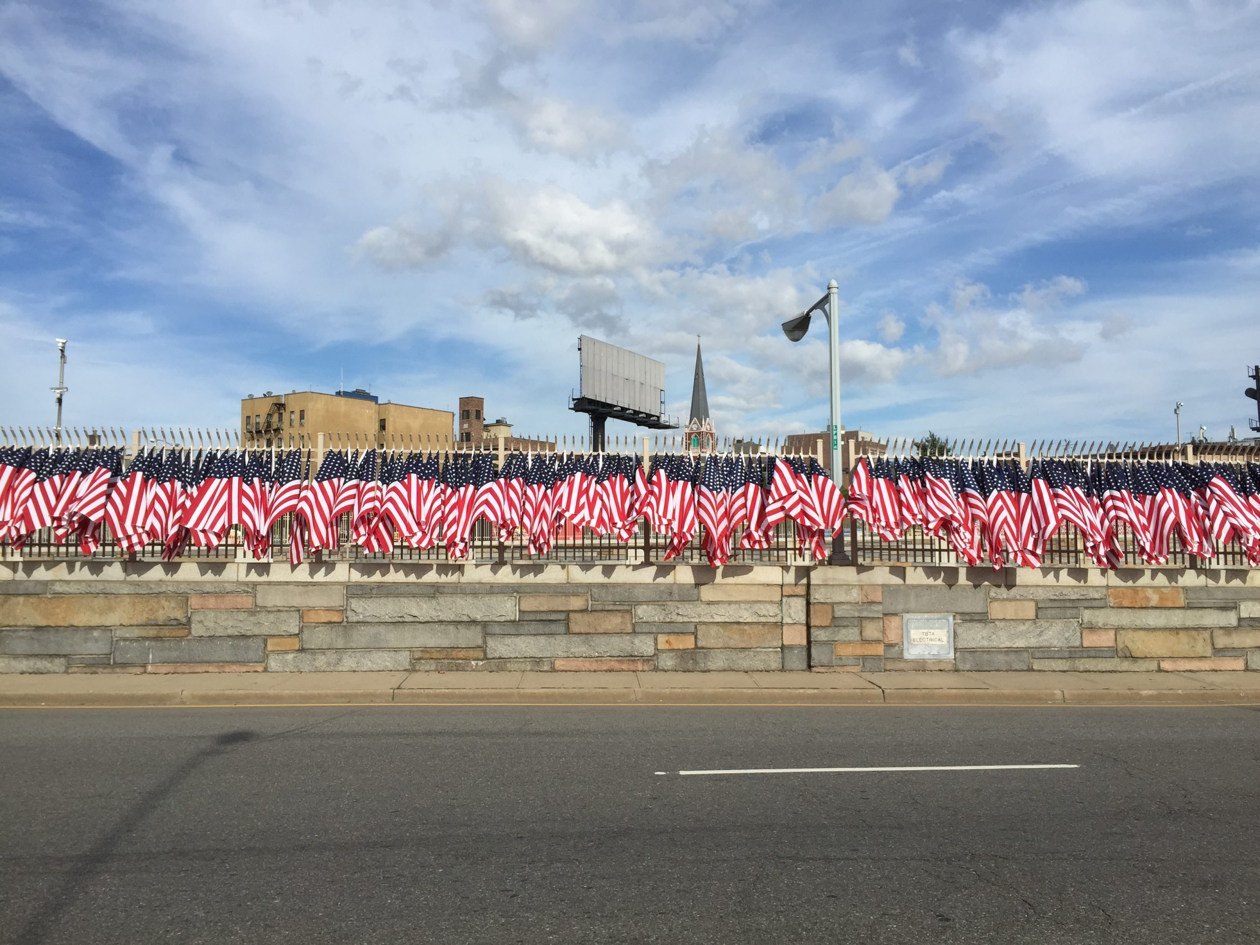 american flags line the side of a road for a running event in new york city