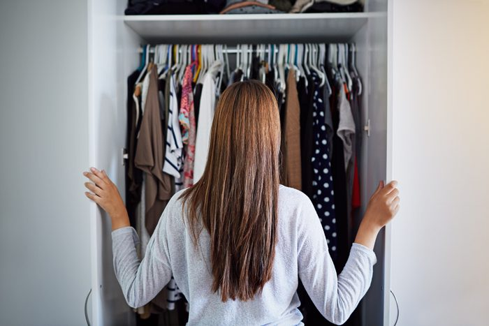 woman inspecting small closet