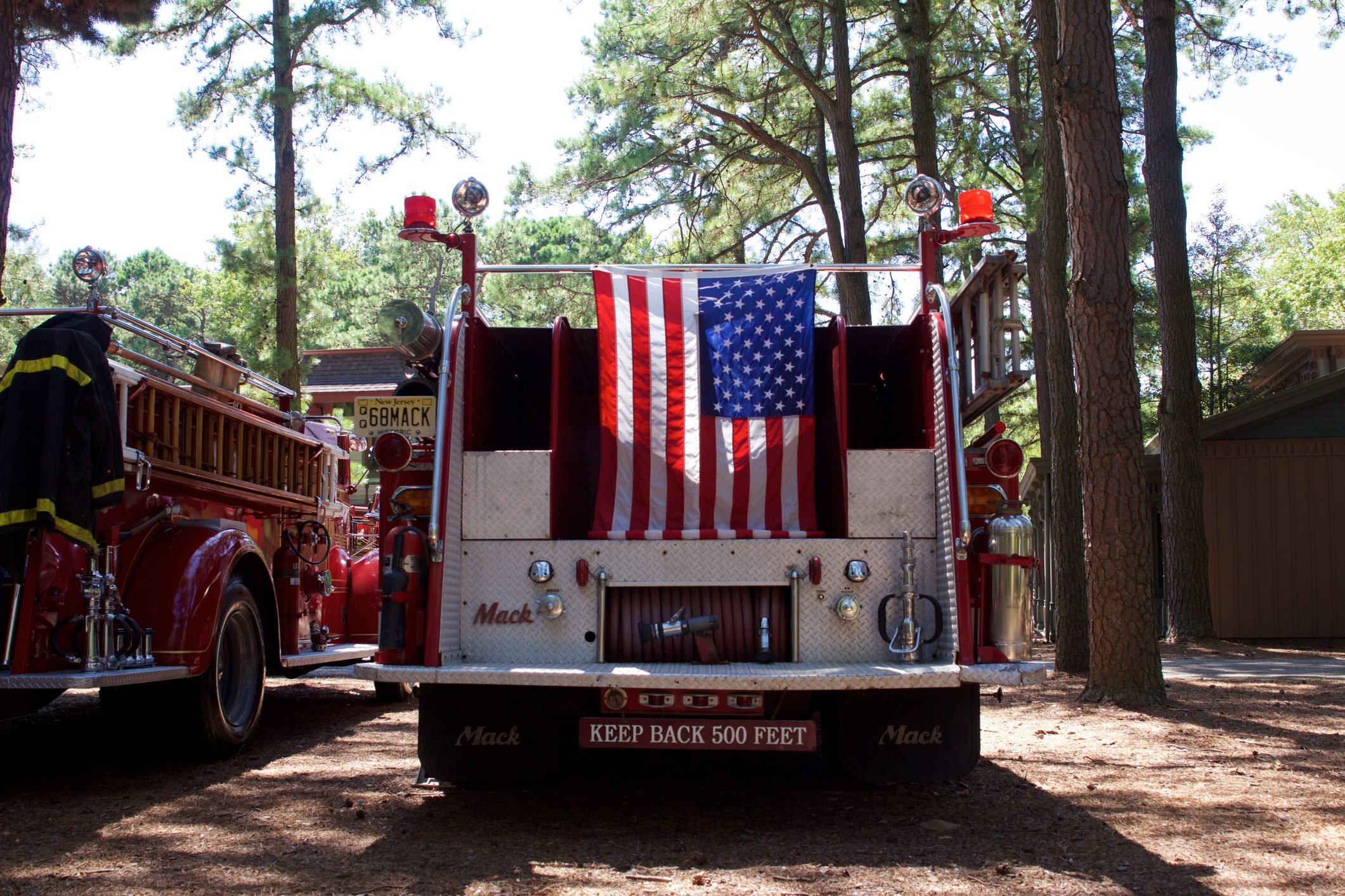 American flag hanging from the back of a vintage Mack fire truck in Millville, New Jersey