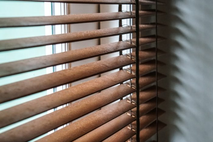 wood blind shade curtain and shadow