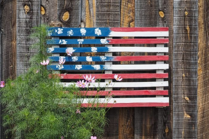 DIY American Flag made from wood on an exterior wood wall
