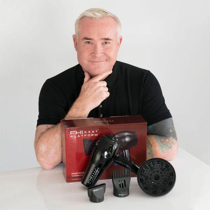 Sean James, Artistic Director of FHI Heat poses with FHI Heat Platform Nano Salon Pro 2000 hairdryer