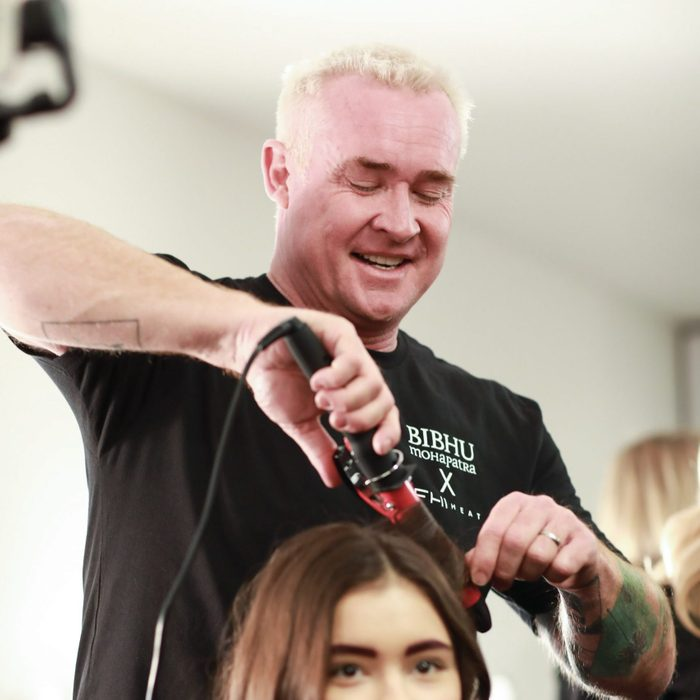 FHI Heat's Artistic Director Sean James syles a model's hair at an event