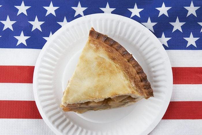 slice of apple pie on a plate on american flag napkin