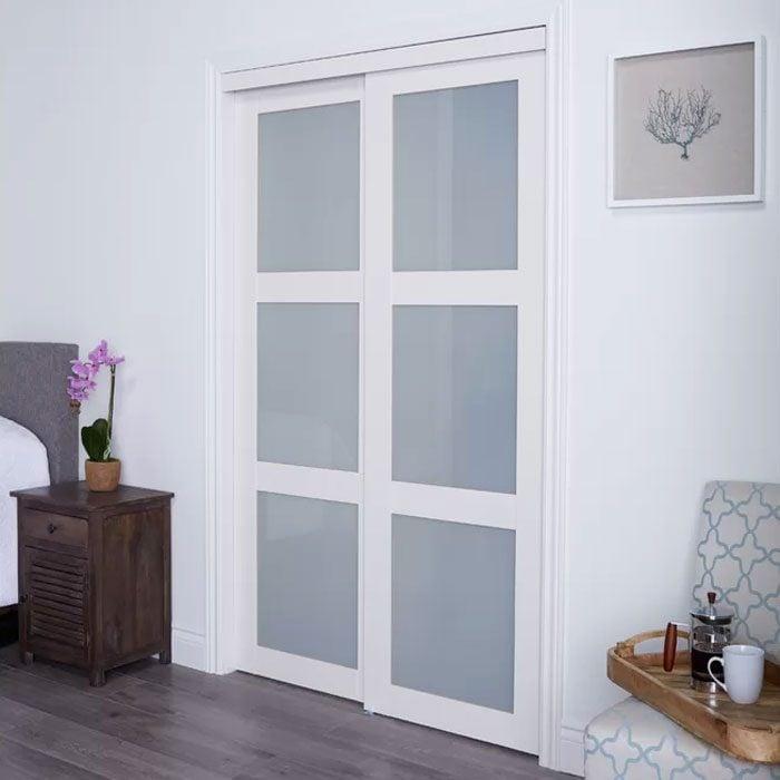 Glass Sliding Closet Doors in a bedroom
