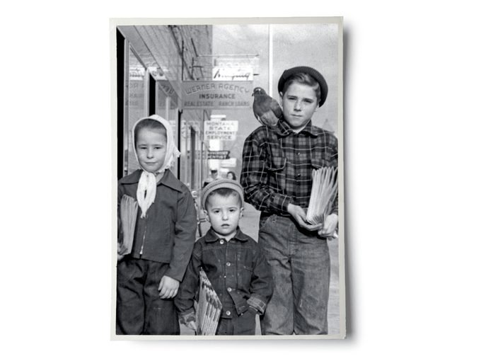 Black and white photo of Jerry, his siblings, and pigeon as children