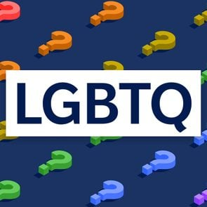 LGBTQ letters over rainbow question mark background