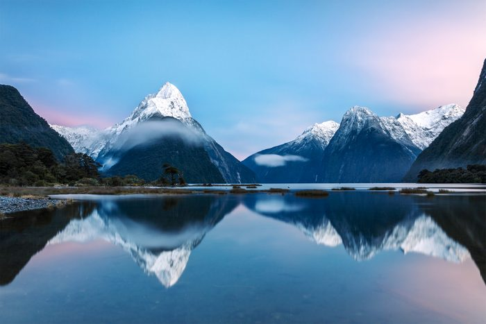 sunrise over Mitre peak and mountains of Milford Sound, Fiordland National Park, Southland, New Zealand