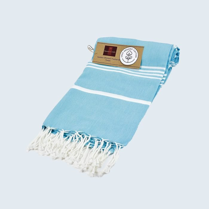 blue and white beach towel with tassels