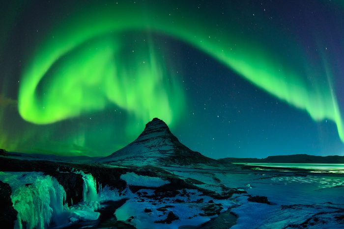Freezing Kirkjufell and Aurora Storm Northern Lights, Iceland
