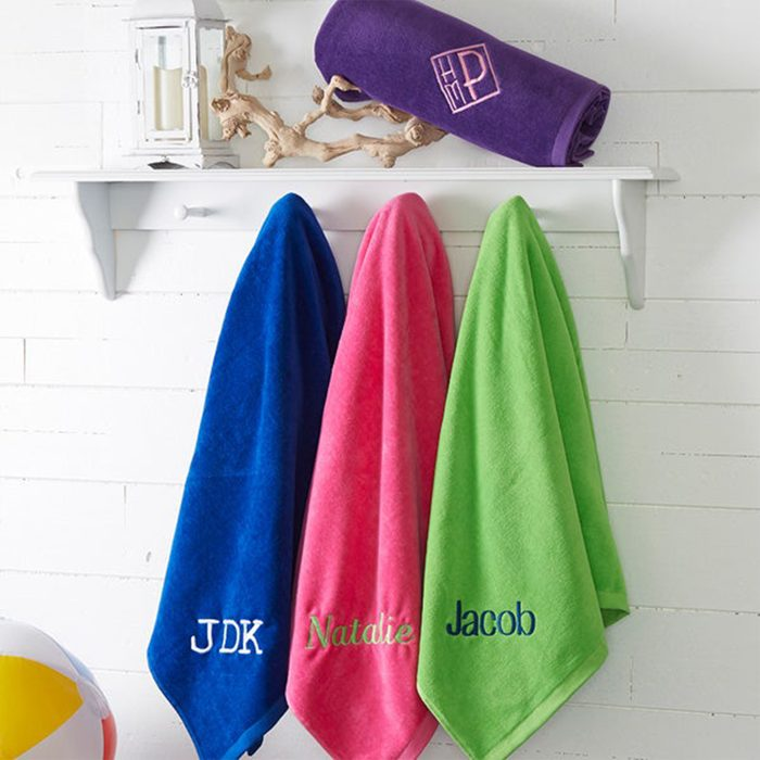 three name personalized towels handing on rack