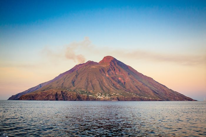Scenic View Of Sea and Sromboli volcanic island During Sunset