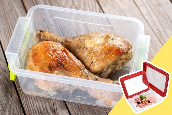 Cooked Chicken in a container with inset of meat containers