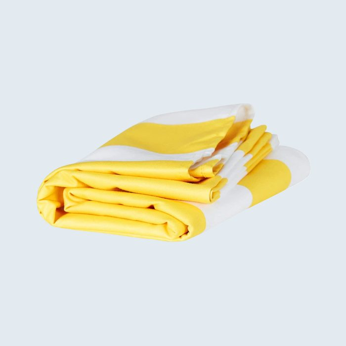 Yellow and white striped folded beach towel