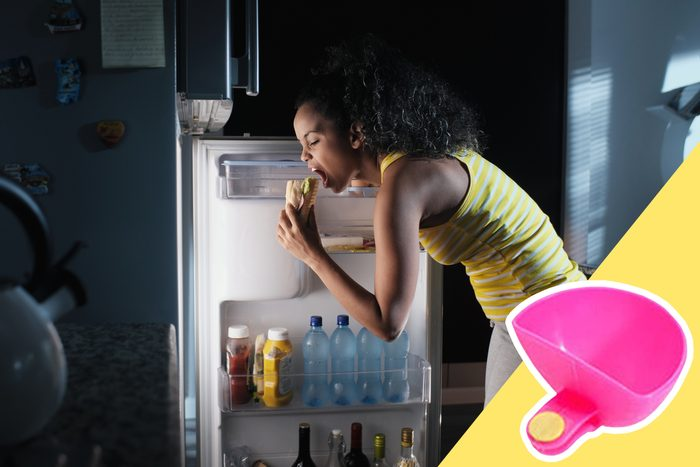 woman eating sandwich out of fridge with inset of a dip container